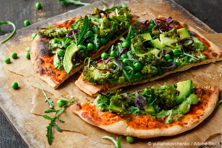 Vegan pizza with vegetables and pesto