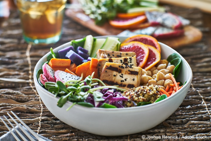 colorful buddha bowl salad with grilled tofu and pea shoots